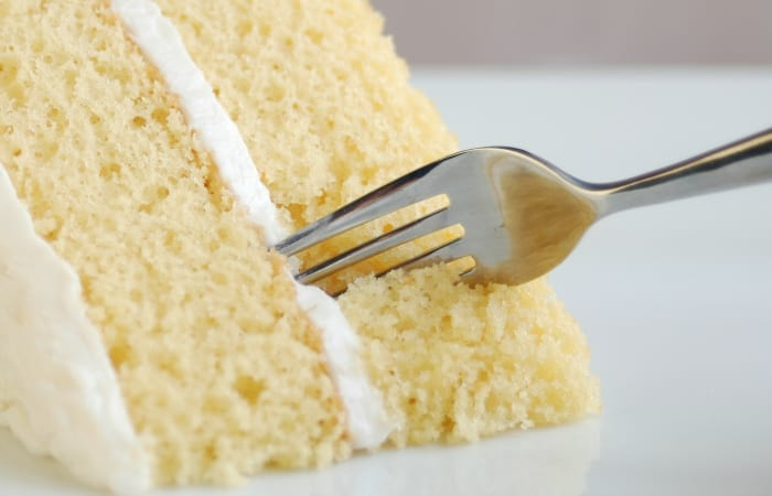 cutting into cake