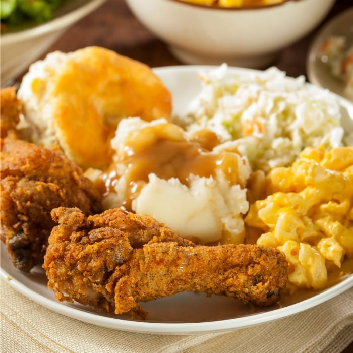 This baked southern fried chicken is just like Grandma used to make...only without the grease dripping down your elbows. Enjoy! | #TotallyTheBomb #friedchicken #recipe #baked #southern #grandmashouse #oven #healthier #tasty #nom
