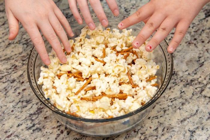 kids reaching for popcorn