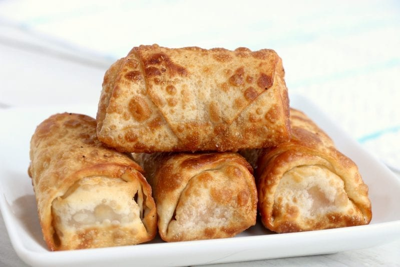 If you ever need a fun snack that really looks hard--but is actually super easy, these fun Peanut Butter Banana Egg Rolls are on the money. #eggroll #eggrollrecipes #snack #snackrecipes