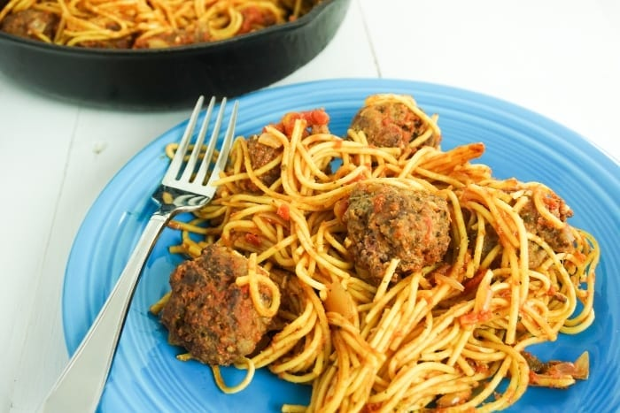 Skillet Spaghetti and Meatballs is the One-Pot Meal You've Waited Your Whole Life For. Not only is it ridiculously good comfort food, but it's easy to make and kind of fun. #onepanmeals #onepotmeals #skilletmeals #skilletspaghetti #spaghettiandmeatballs #meatballs