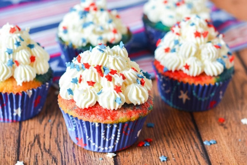 If you're thinking about the big July 4th BBQ you're going to throw, these Patriotic Cupcakes are the Perfect July 4th Dessert. They're super easy and fun to make--and they taste like a million bucks. #july4th #july4thdesserts #patrioticdesserts