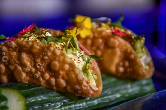 lobster tacos on a log of cucumber